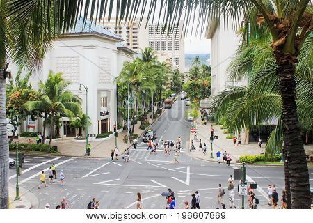 Honolulu, Hawaii, USA - May 30, 2016: Downtown Waikiki, bustling with locals and tourists