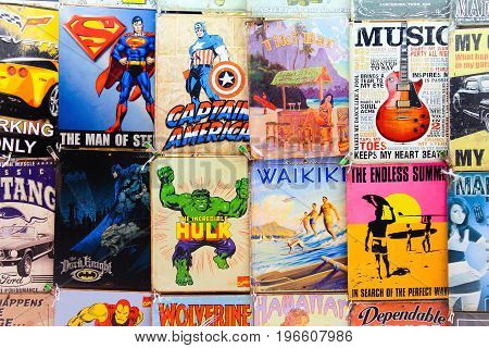 Honolulu, Hawaii, USA - May 30, 2016: Old Comics and signs for sale at a Waikiki Market Stall