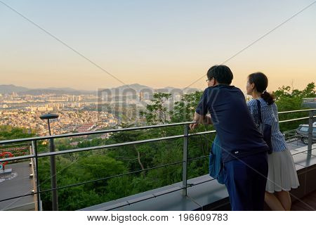 SEOUL, SOUTH KOREA - CIRCA MAY, 2017: people watch Seoul city view from Namsan Mountain in central Seoul. Seoul Special City is the capital and largest metropolis of the Republic of Korea.