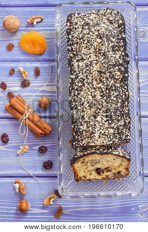 Fresh Baked Fruitcake And Ingredients On Purple Boards