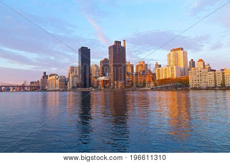A view on Manhattan from Roosevelt Island at sunrise New York USA. East rivet and Manhattan panorama at dawn.