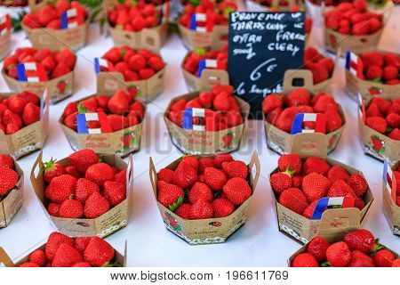 Nice France - May 26 2017: Ripe red strawberries at a local outdoor farmers market in Nice France