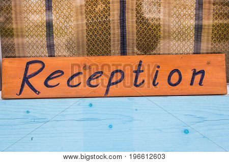 Reception sign at a hotel. Inscription reception