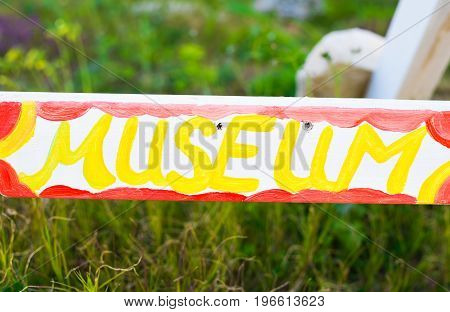 Signboard of Museum. Museum direction sign in green area