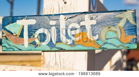 Handmade painted inscription toilet, wc sign on board