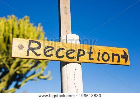 Reception sign at a hotel. Inscription reception