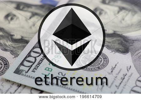 Ethereum symbol in black and whtie color on 100 dollar bill background.