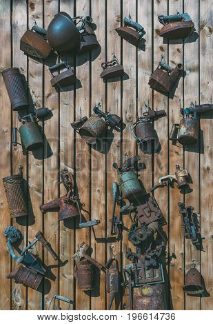 Collection of aged vintage tools and accessories on wooden wall
