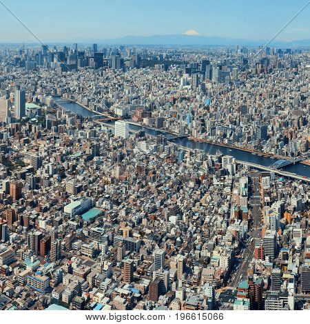 Tokyo urban skyline rooftop view and river, Mt Fuji, Japan.