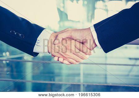 Handshake of businessmen in vintage tone soft focus