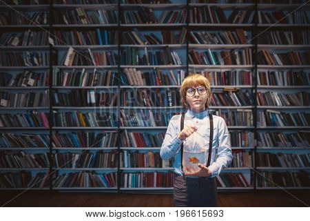 Boy with a goldfish in library