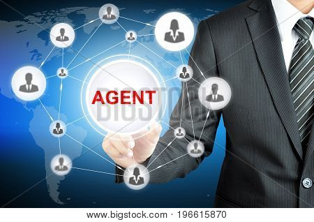 Businessman pointing to AGENT word on virtual screen