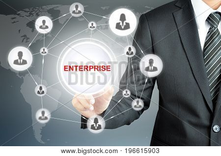 Businessman pointing to ENTERPRISE sign with businesspeople icon network on virtual screen