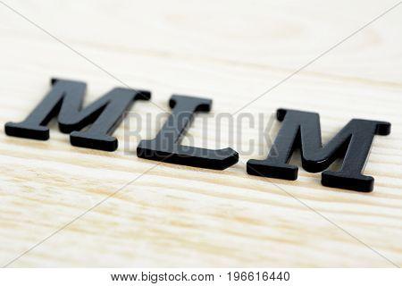 MLM (or Multi-Level Marketing) sing on wood background
