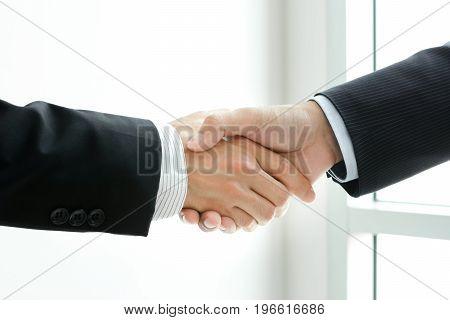 Handshake of businessmen - greetingdealing & partnership concepts