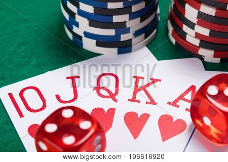 set of red wins in poker on a poker table with chips and dice