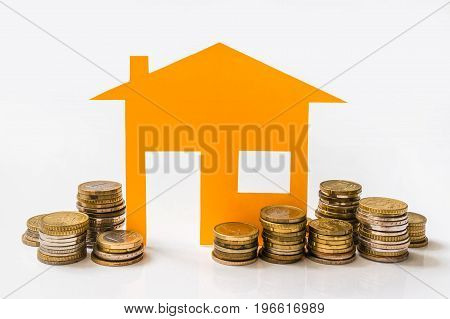 Paper House And Stack Of Coins Isolated On White