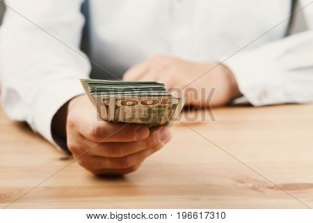 Man in shirt giving money. Loan, finance, salary, bribe and donate concept.