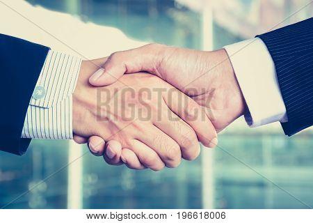 Handshake of businessmen vintage tone - congratulation greeting & business partner concepts