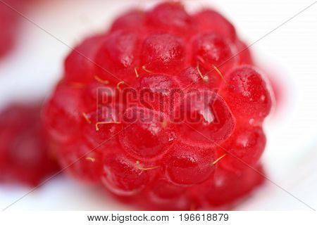 A background of ripe red raspberry with milk