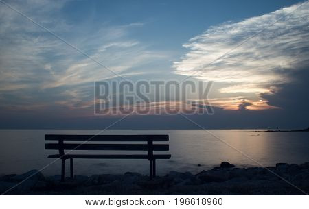 Bench by the sea at sunset in Croatia - Umag.