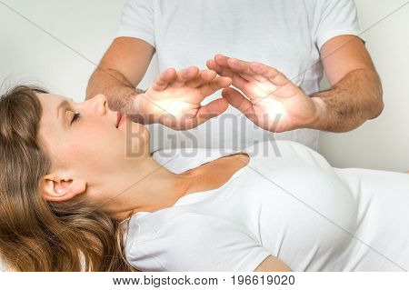 Young Woman Having Reiki Healing Treatment