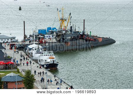PEENEMUENDE GERMANY - JULY 18 2017: View on Peenemuende seaport on the Baltic Sea island of Usedom. In the background the Soviet Juliett-class submarine K-24 (U461).