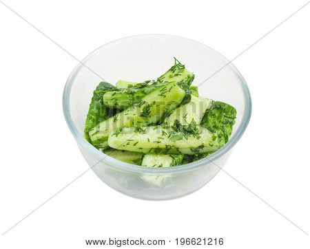 Lightly salted cucumber in the glass bowl on a white background