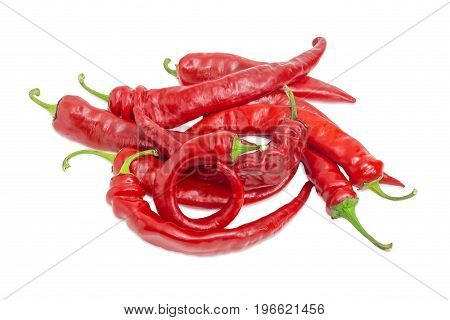 Pile of the fresh red peppers chili on a light background