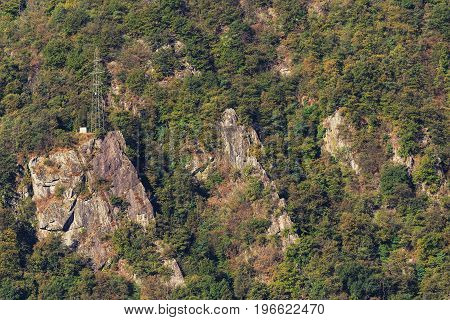 Slope of a mountain in the Alps as seen at the middle of autumn from the city of Bellinzona in the Swiss canton of Ticino.