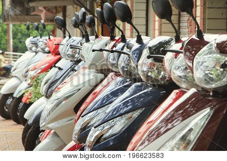 Goa India - March 05 2015: Scooters parked on a city street