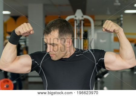 Young And Attractive Bodybuilder Posing In Gym