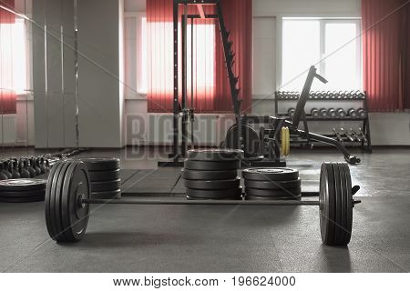 Muscular Man Doing Heavy Deadlift Exercise n gym