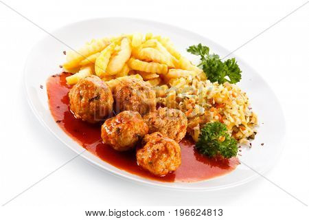 Meatballs with french fries and vegetables