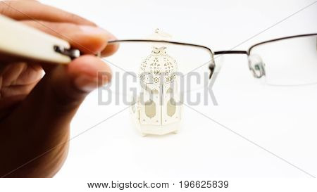 Man Hand Is Testing Eye Glasses's Lens With Decorate Lantern Case