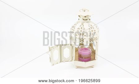 Decorate White Metal Lantern Case With Glass Of Colorful Candle