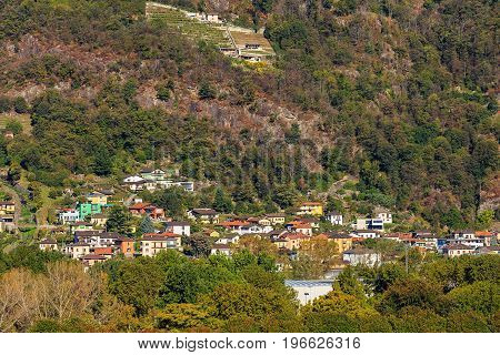 Buildings of the city of Bellinzona in the Swiss canton of Ticino surrounded by mountains. The picture was taken at the middle of autumn.