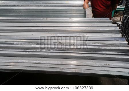 close up white stain on galvanized steel sheet in tube in warehouse