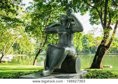 Sculpture mother and the son in the Lumpini park Taken in Bangkok Thailand on 16 May 2017