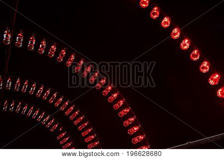 Empty Coca Cola Bottles Are Arranged And Illuminated With Red Lights