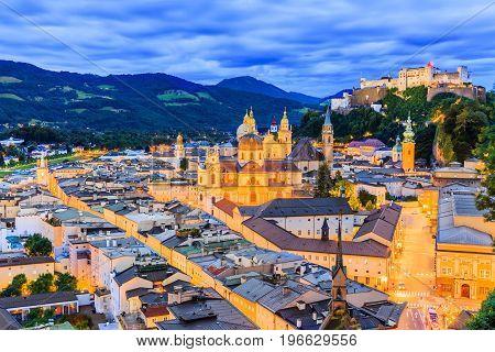 Salzburg Austria. Festung Hohensalzburg fortress and Salzburger Dom at twilight.