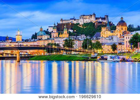 Salzburg Austria. Festung Hohensalzburg fortress Salzburger Dom and Salzach river at twilight.