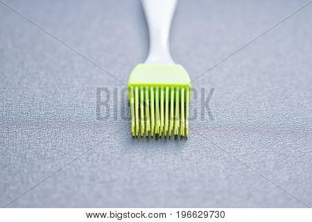 green silicone pastry brush on the blue background