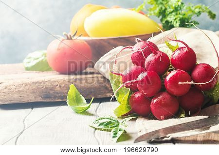 Large bunch of fresh radish on white wooden table, closeup