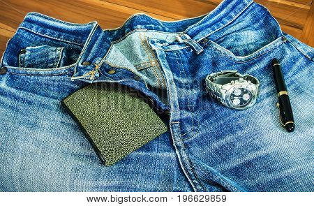 Nice blue jeans in vintage style on wood table
