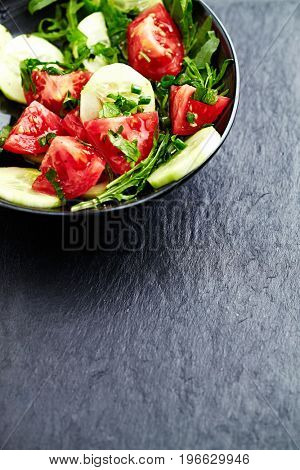 Healthy salad with tomatoes and rucola