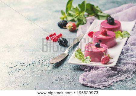 Summer dessert with berries and yogurt as a jelly pudding