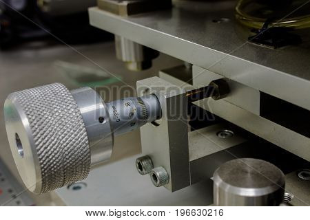 Using a Micrometer With machine Or high resolution work and setup on machine for electronic industry.