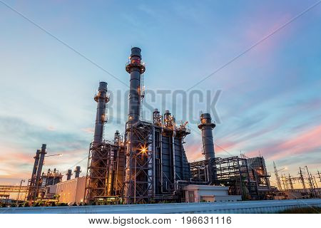 Gas turbine electrical power plant at dusk with twilight