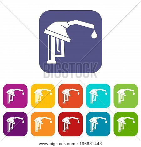 Gasoline pump nozzle icons set vector illustration in flat style in colors red, blue, green, and other